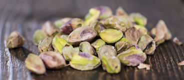 Peeled Pistachios on wood Stock Photography