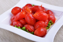 Peeled plum tomatoes. On a plate Stock Photography