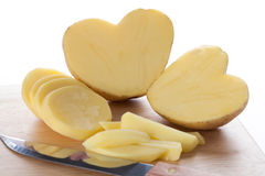 Peeled potatoe hearts Stock Image
