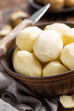 Peeled potatoes Stock Images