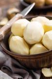 Peeled potatoes Stock Images