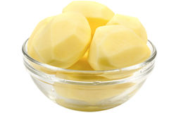 Peeled potatoes in a glass bowl Stock Photos
