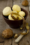 Peeled potatoes. On an old table Stock Photos