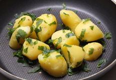 Peeled potatoes in pan Stock Images