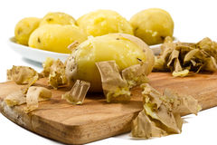 Peeled potatoes Stock Photos