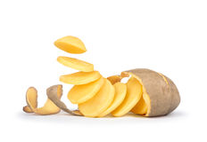 Peeled potatoes with the skin as a spiral pieces of potatoes fal Royalty Free Stock Photo