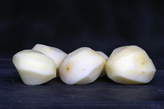 Peeled potatoes Stock Photos