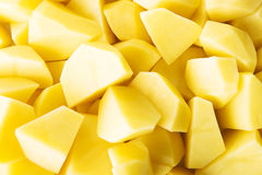 Peeled potatos Stock Images
