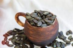 Peeled pumpkin seeds closeup. Good folk anthelmintic. Stock Image