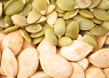 Peeled pumpkin seeds or whole background macro Stock Photography