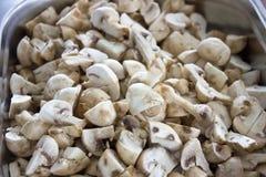 Peeled raw mushrooms champignons close-up. Selective focus royalty free stock photo