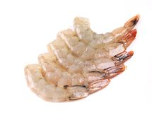 Peeled raw prawns. Isolated on a white background Stock Photography