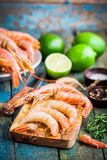 Peeled Raw Prawns On A Wooden Cutting Board With Salt, Pepper, Lime Stock Image
