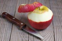 Peeled red apple Stock Photos