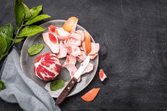 Peeled red grapefruit with knife on the grey plate Stock Images