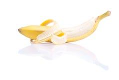 Peeled ripe banana isolated on a white background with reflectio Royalty Free Stock Image