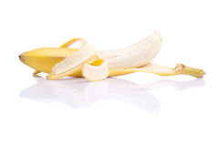 Peeled ripe banana isolated on a white background with reflectio Royalty Free Stock Photo