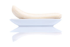 Peeled ripe banana in a plate isolated on a white background wit Royalty Free Stock Photos