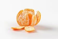 Peeled ripe tangerine Royalty Free Stock Images