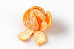 Peeled ripe tangerine Royalty Free Stock Photography
