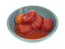 Peeled ripe tomatoes in old bowl Stock Photography