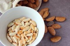 Peeled roasted almonds. Stock Photo