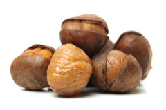 Peeled roasted chestnuts. Chinese food, peeled roasted chestnuts on white background Royalty Free Stock Image