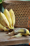 Peeled rotten banana on board Royalty Free Stock Photos