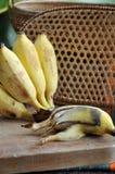 Peeled rotten banana on board Royalty Free Stock Photos