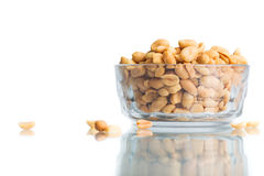 Peeled and salted peanuts in a bowl. Isolated on a white backgro Royalty Free Stock Photography