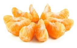 Peeled segments of tangerine. Isolated on white Stock Photos