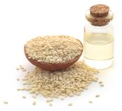 Peeled sesame seeds with oil. In a bottle over white background Royalty Free Stock Photo