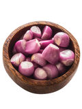 Peeled shallots. Close up of a bowl of peeled shallots isolated Stock Photos