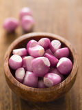 Peeled shallots. Close up of a bowl of peeled shallots Royalty Free Stock Photography
