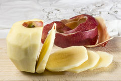 Peeled and sliced apple Stock Photography
