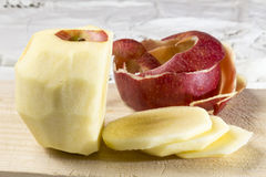 Peeled and sliced apple Royalty Free Stock Image