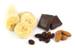 Peeled sliced banana with chocolate, almonds and raisins Royalty Free Stock Images