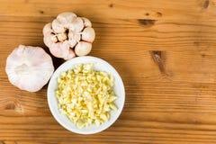 Peeled and sliced garlic cloves with whole garlic bulb Stock Photos