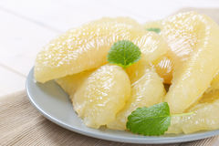 Peeled and sliced pomelo. Plate of peeled and sliced pomelo - close up Royalty Free Stock Images