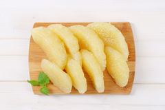 Peeled and sliced pomelo Royalty Free Stock Photography