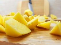 Peeled and sliced potatoes royalty free stock photo