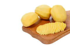 Peeled and slised potato Stock Photos