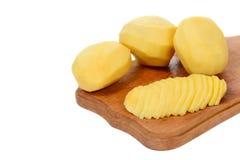 Peeled and slised potato Stock Photos