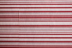 Peeled stripe wallpaper. Old and peeled wallpaper on a background Stock Photography