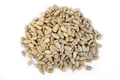 Peeled sunflower seeds on white Royalty Free Stock Photos