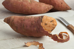 Peeled sweet potato Stock Image