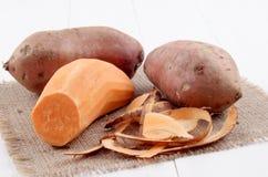 Peeled sweet potato and potato peel Royalty Free Stock Photo