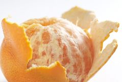 Peeled tangerine. Close u pof a peeled tangerine on white. See all my food & drink images here stock photography
