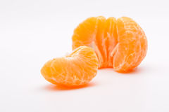 Peeled tangerine. On a white background Royalty Free Stock Image
