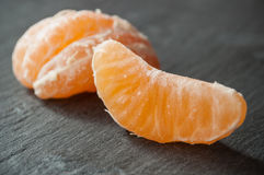 Peeled tangerine on chalkboard background Stock Photography
